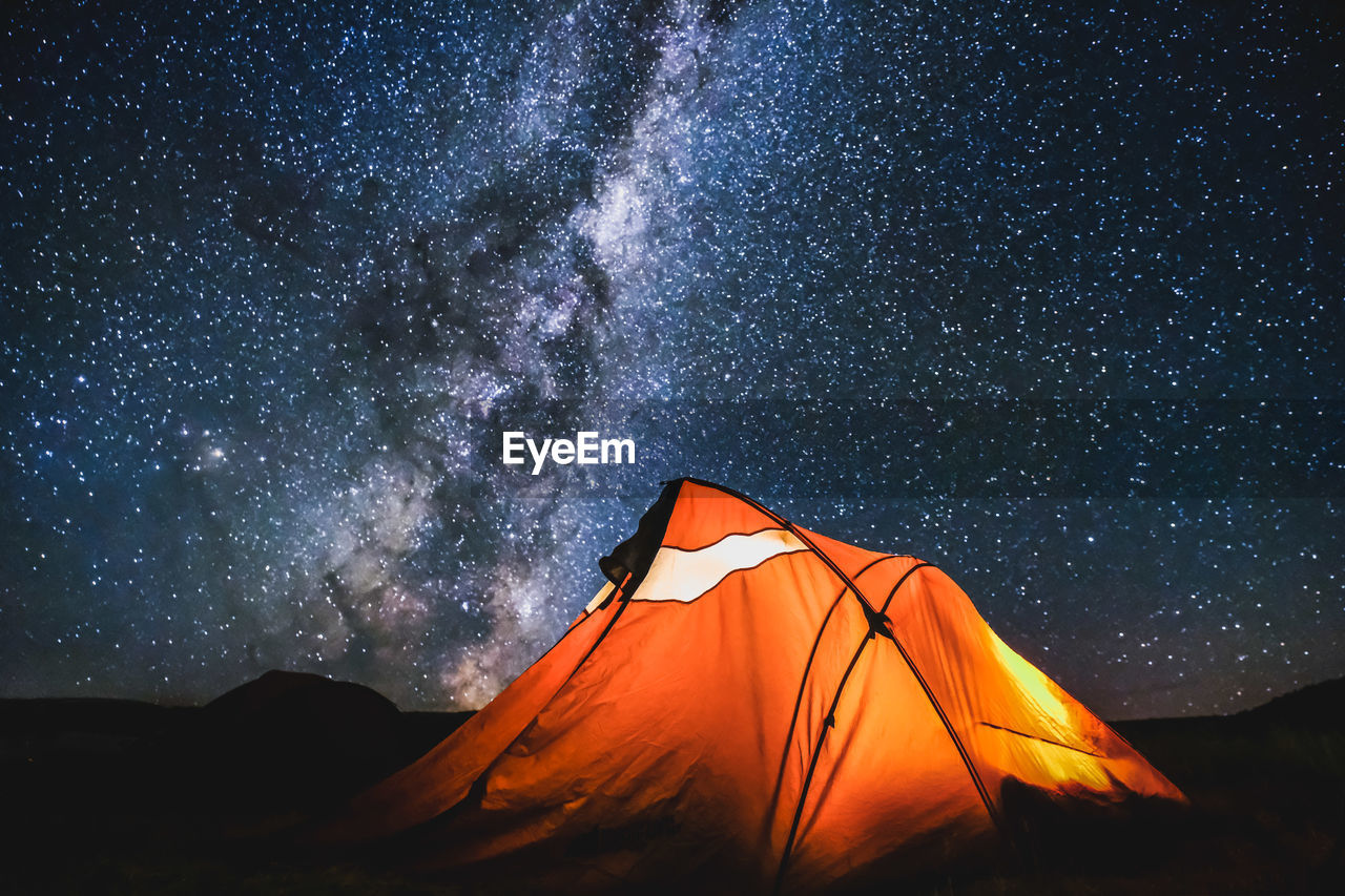 Tent On Field Against Starry Sky At Night