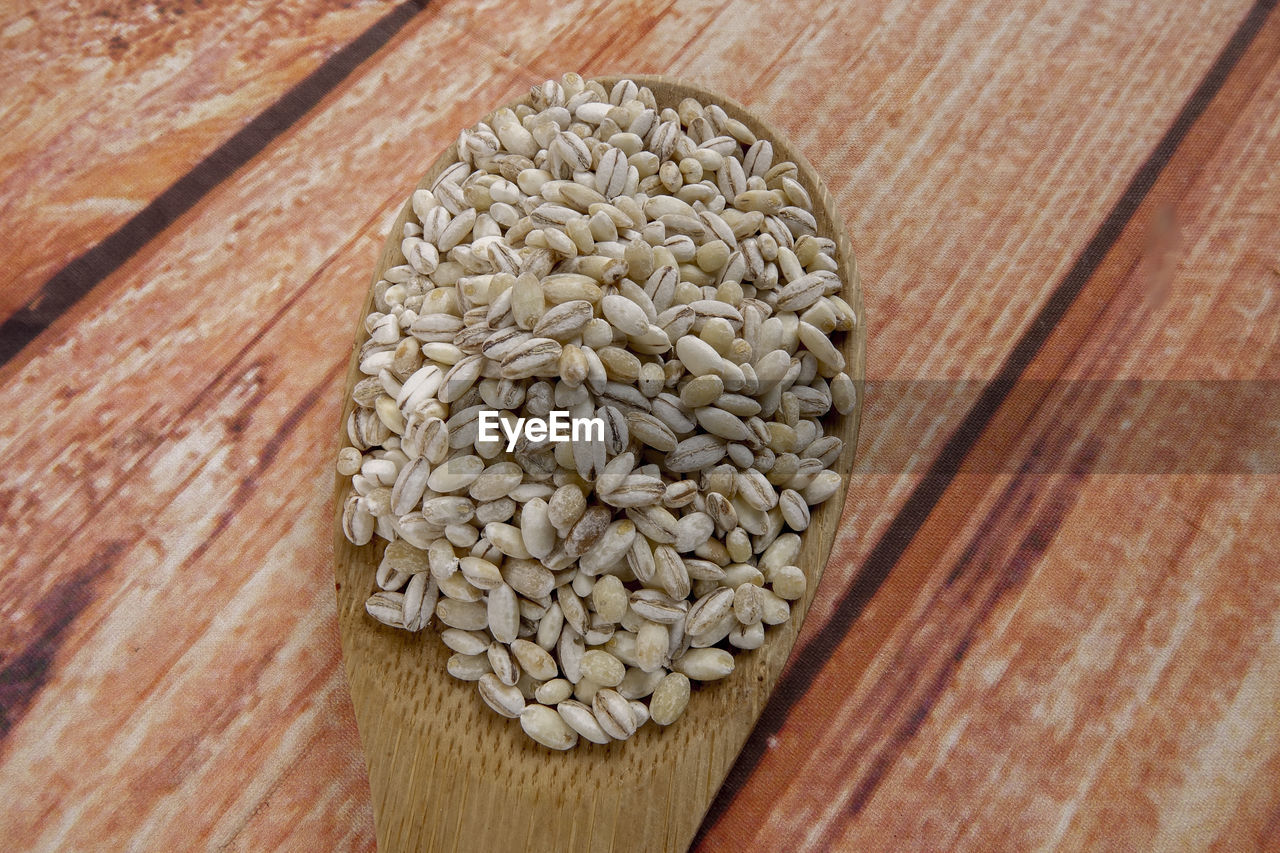food and drink, food, wood - material, healthy eating, still life, freshness, table, no people, wellbeing, close-up, indoors, raw food, high angle view, large group of objects, brown, abundance, directly above, wood, focus on foreground, nature, wood grain