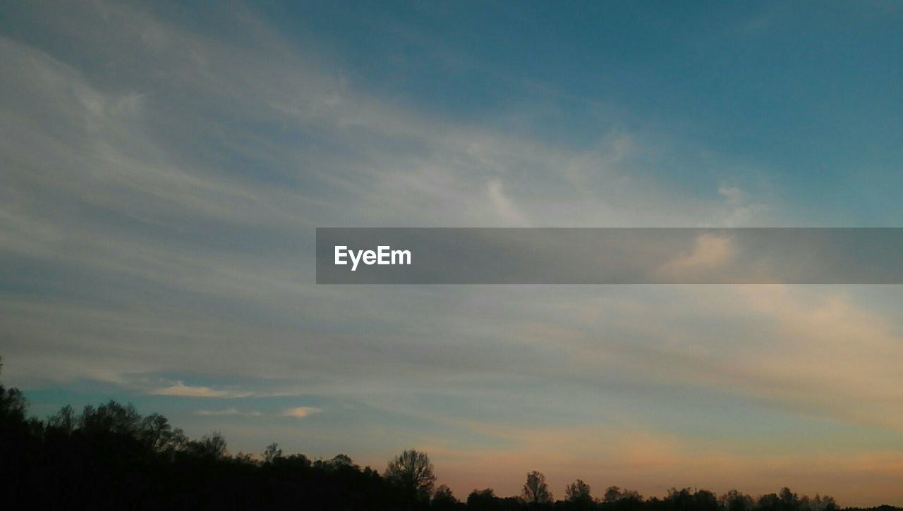 sky, scenics, beauty in nature, tranquility, tree, nature, tranquil scene, cloud - sky, sunset, silhouette, outdoors, no people, low angle view, day