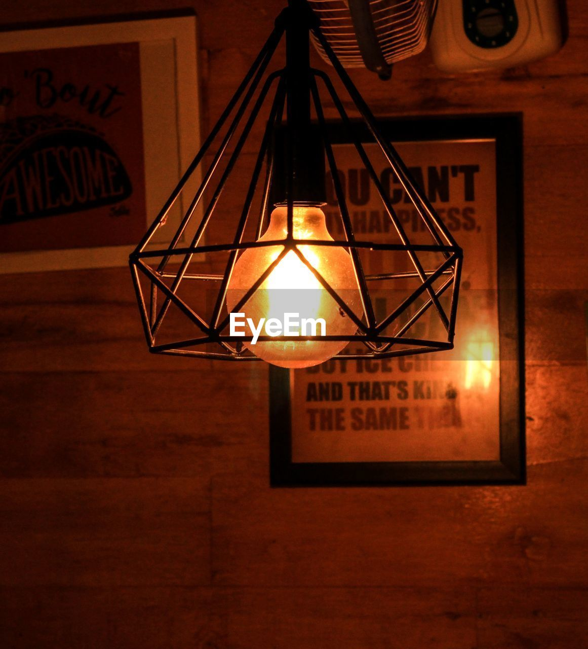 illuminated, hanging, lighting equipment, indoors, no people, electricity, light, electric lamp, glowing, wall - building feature, electric light, pendant light, architecture, light - natural phenomenon, home interior, close-up, frame, low angle view, technology, ceiling, stage, electrical equipment