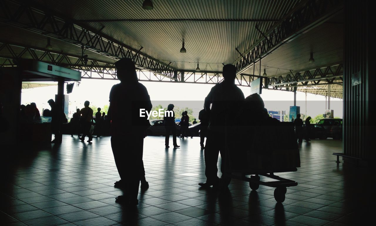 indoors, real people, silhouette, medium group of people, men, full length, travel, women, luggage, lifestyles, day, people, adult