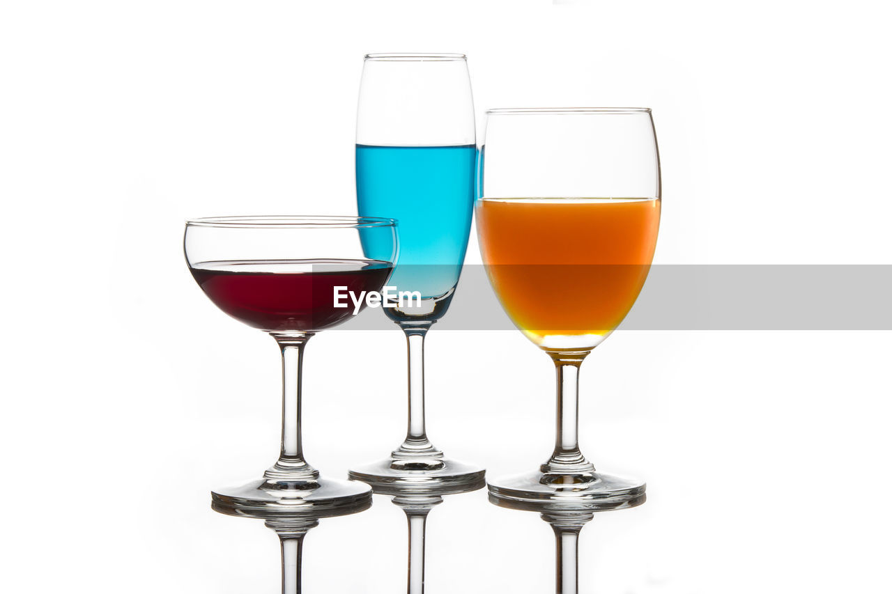 drink, refreshment, glass, food and drink, alcohol, studio shot, white background, indoors, glass - material, close-up, wineglass, freshness, drinking glass, still life, transparent, no people, household equipment, cut out, red, food, red wine, cocktail