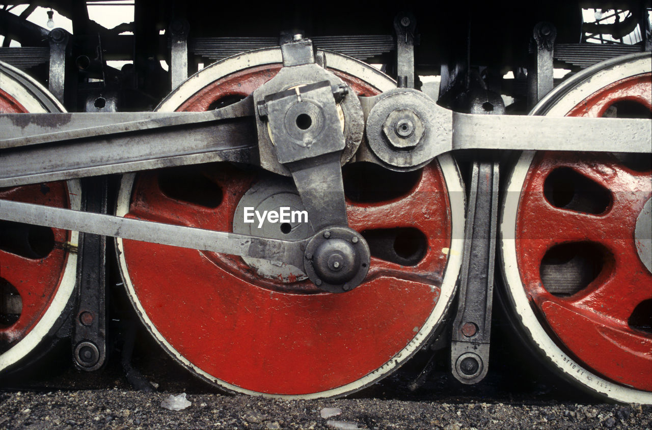 transportation, wheel, metal, red, no people, mode of transportation, rail transportation, machinery, land vehicle, close-up, circle, connection, train, track, geometric shape, machine part, day, train - vehicle, shape, outdoors, silver colored