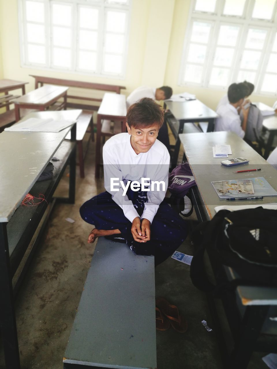 sitting, real people, indoors, boys, desk, full length, childhood, one person, day