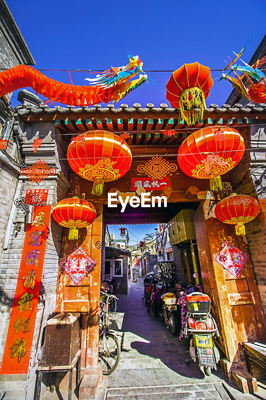 lantern, chinese lantern, hanging, cultures, architecture, lighting equipment, built structure, outdoors, chinese lantern festival, day, celebration, chinese new year, no people, building exterior, sky