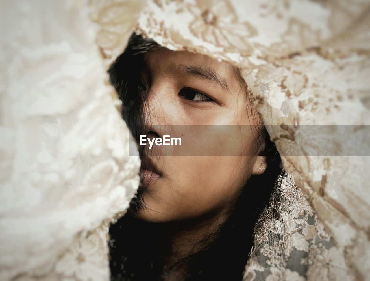 Low Angle View Of Girl In Veil