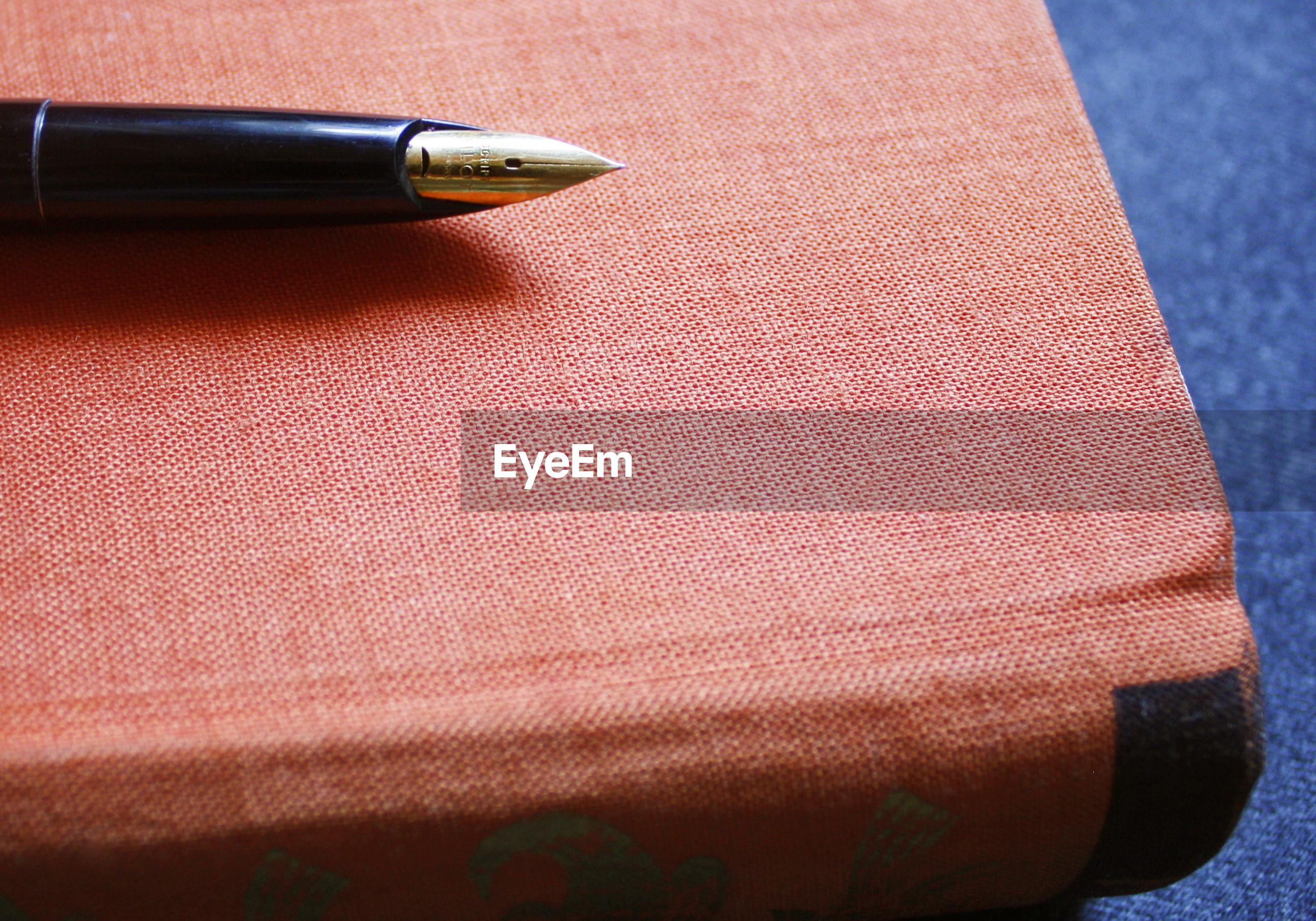 High angle view of book and pen on table