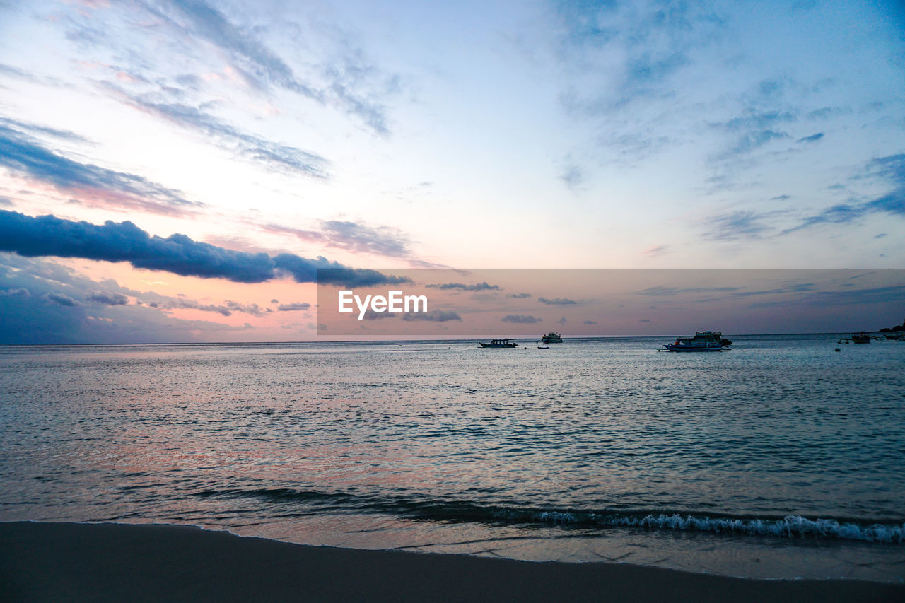 sky, sea, water, scenics - nature, sunset, beauty in nature, cloud - sky, tranquility, tranquil scene, horizon over water, horizon, beach, land, idyllic, no people, nature, non-urban scene, outdoors, remote