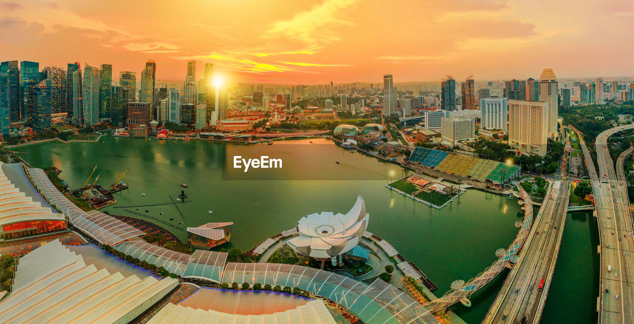 Panoramic View Of River And Buildings Against Sky During Sunset