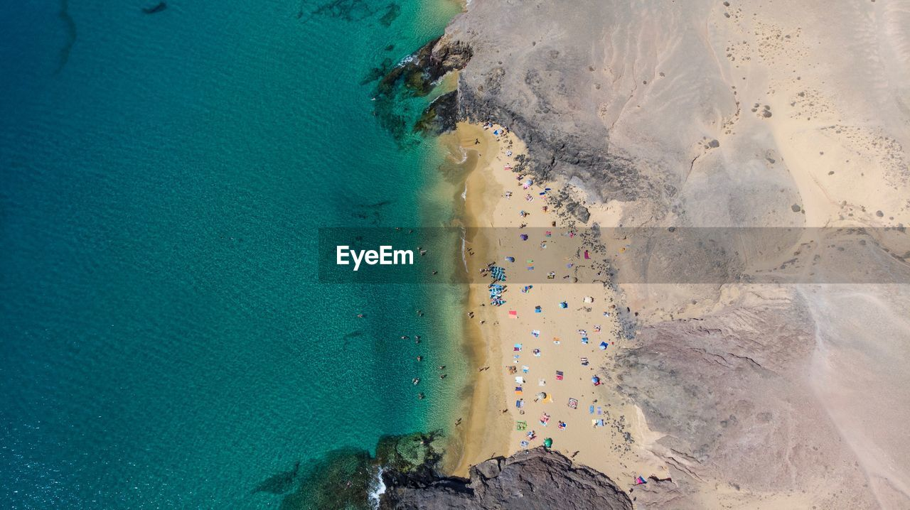water, land, beach, beauty in nature, sea, high angle view, scenics - nature, nature, sand, day, tranquil scene, tranquility, aerial view, outdoors, non-urban scene, rock, idyllic, solid, rock - object, no people, turquoise colored