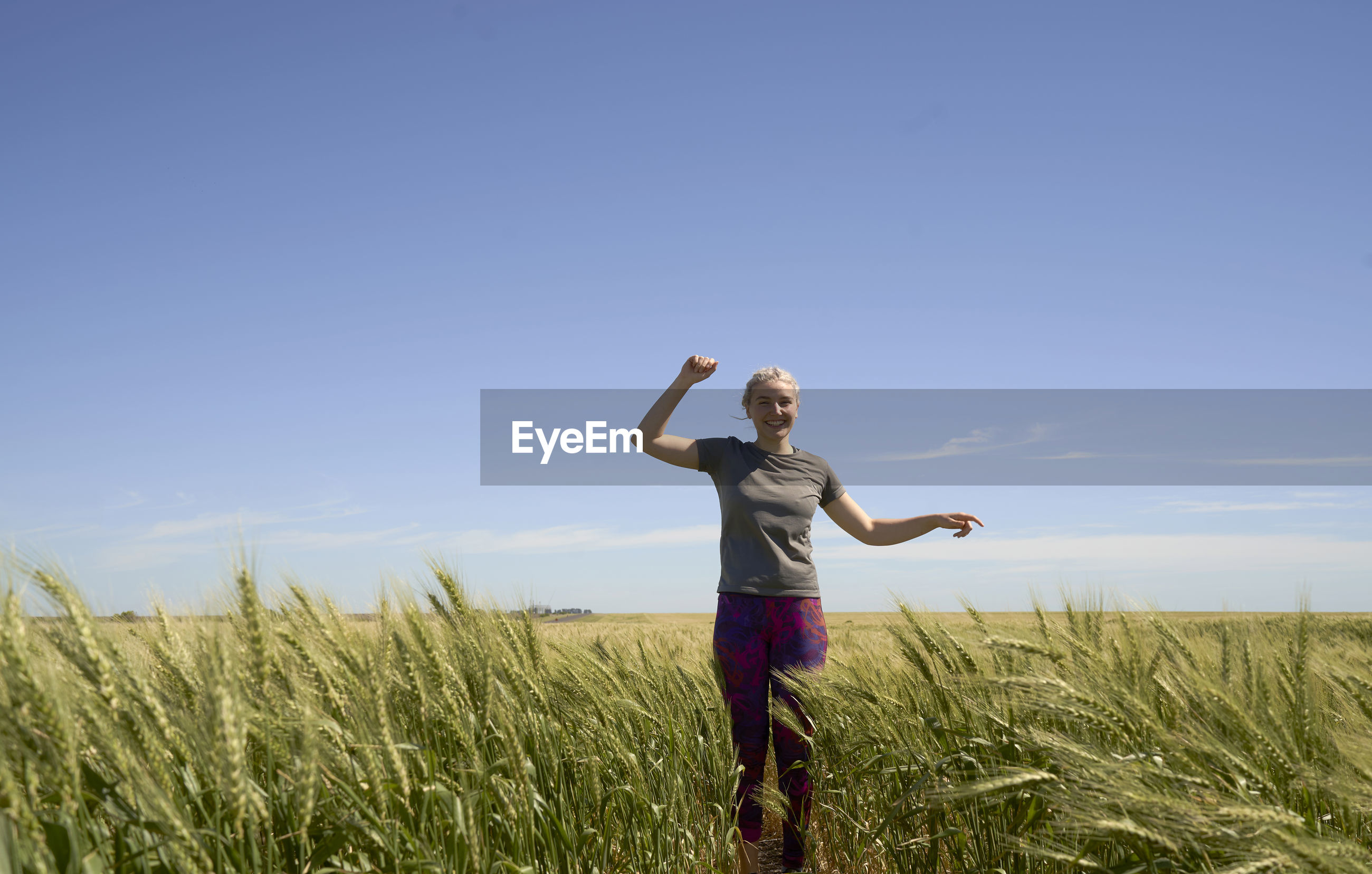 Full body of young woman runner background agriculture field
