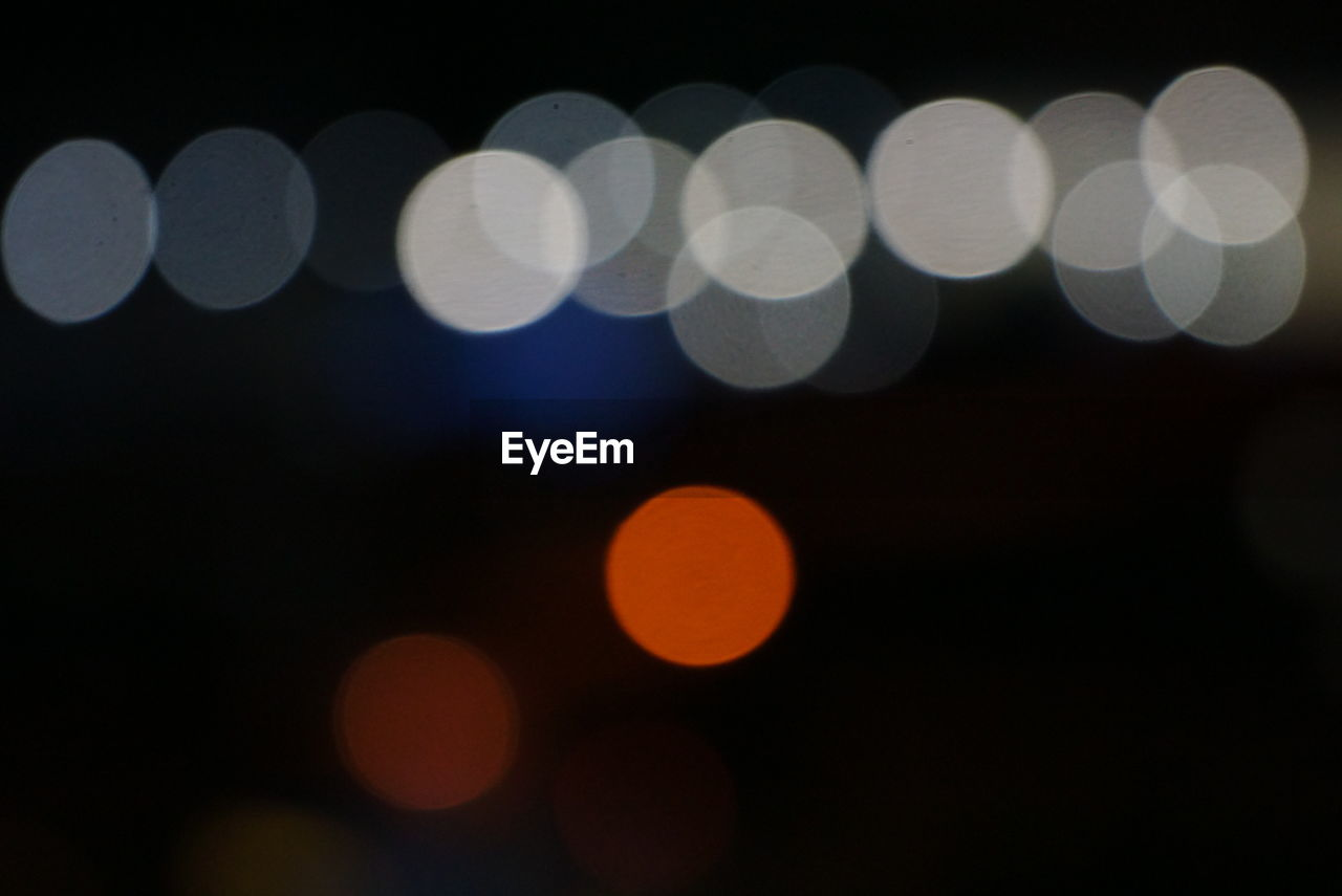 night, defocused, glowing, illuminated, light effect, celebration, no people, abstract, backgrounds, outdoors, party - social event, close-up