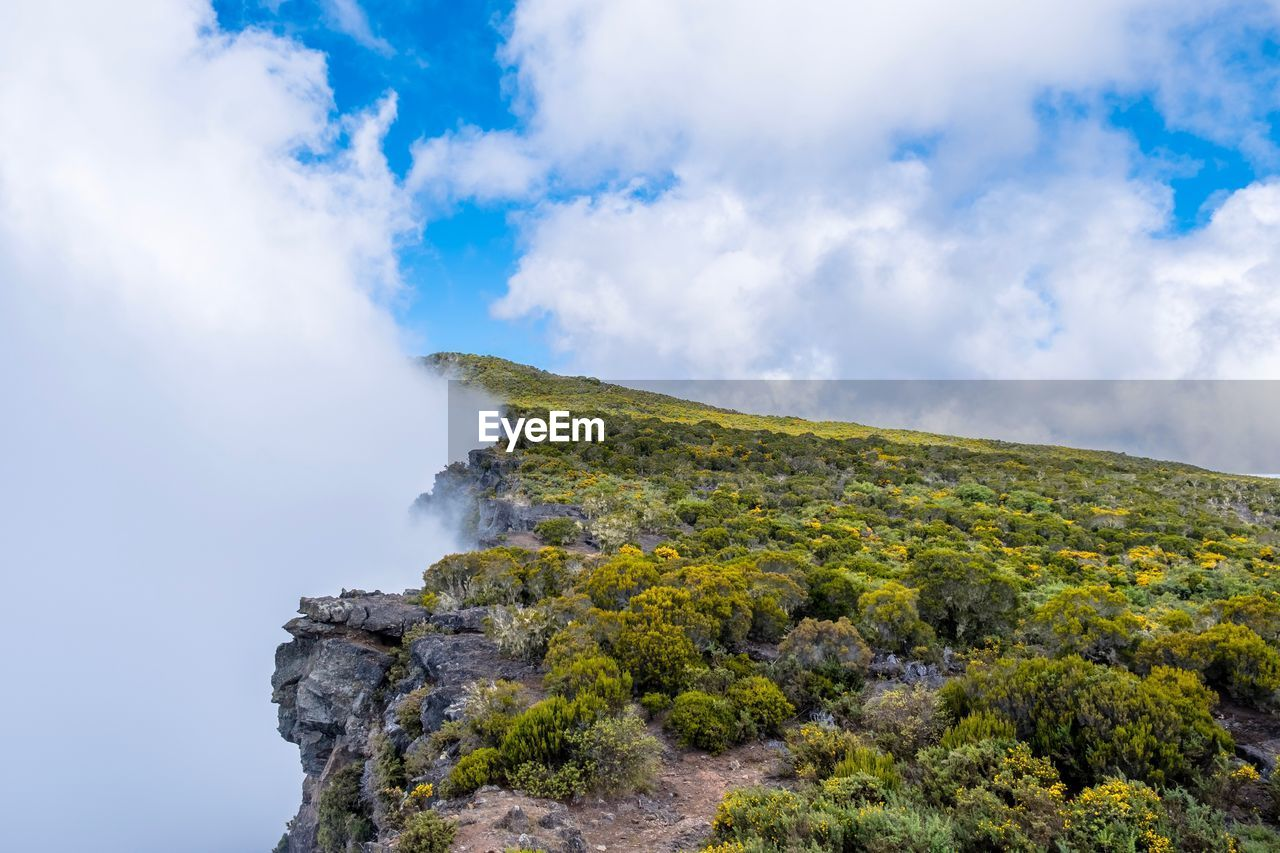 cloud - sky, sky, mountain, scenics - nature, beauty in nature, tranquil scene, non-urban scene, tranquility, geology, nature, day, rock, no people, landscape, environment, physical geography, idyllic, solid, rock - object, travel, outdoors, power in nature, formation, volcanic crater, mountain peak