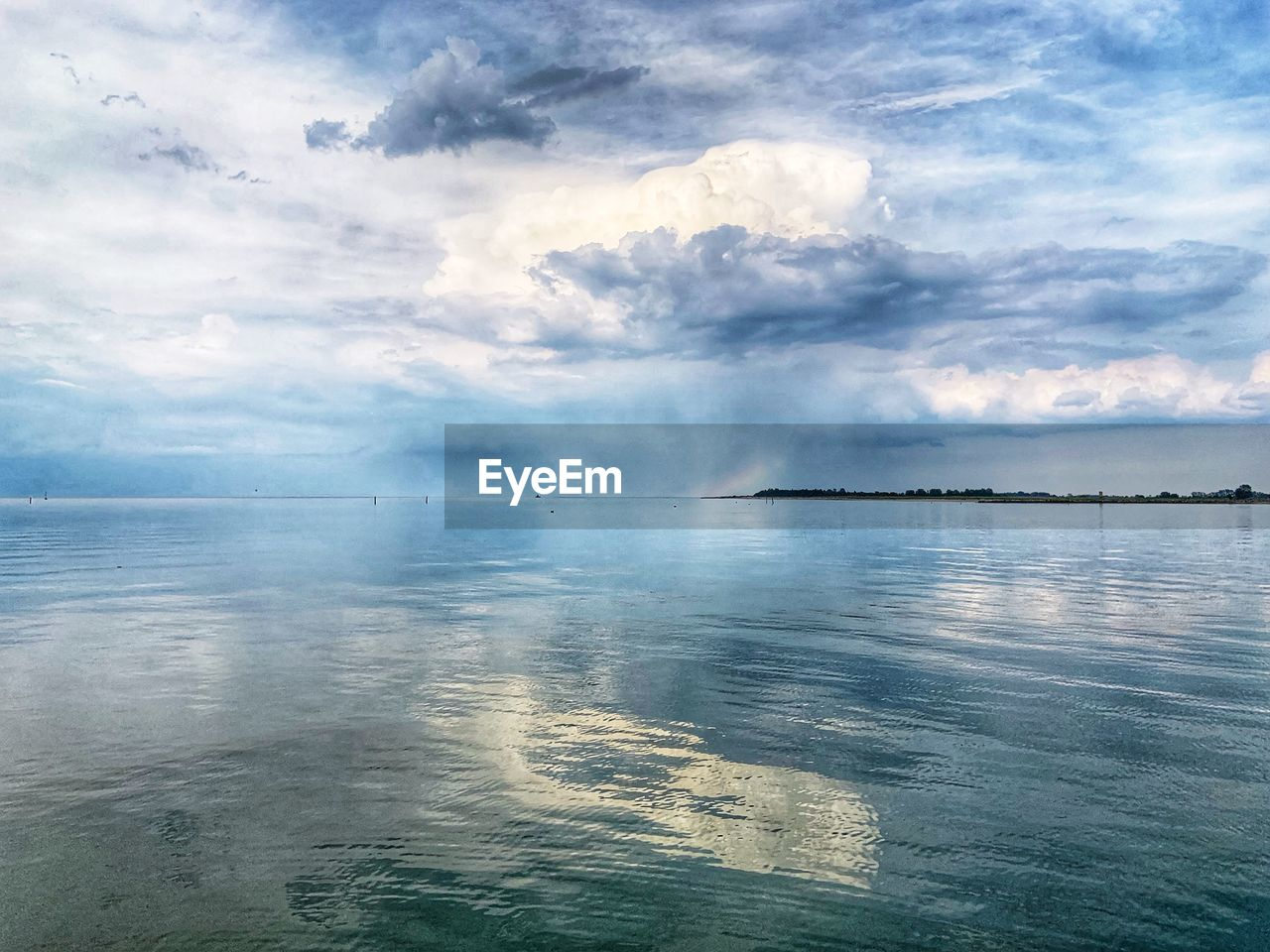 beauty in nature, water, sky, cloud - sky, scenics - nature, tranquil scene, tranquility, waterfront, sea, day, nature, no people, idyllic, non-urban scene, outdoors, reflection, remote, power in nature