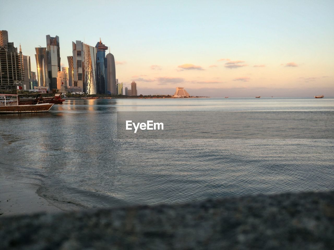 sky, water, built structure, building exterior, architecture, sea, city, skyscraper, office building exterior, urban skyline, nature, landscape, sunset, building, waterfront, scenics - nature, no people, cityscape, beach, outdoors, horizon over water, financial district