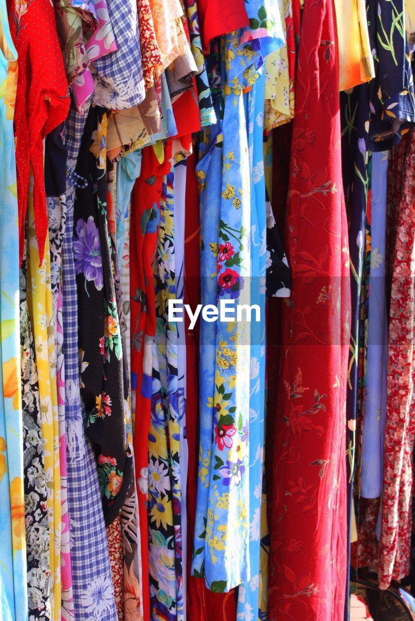 multi colored, retail, variation, for sale, choice, textile, market, hanging, retail display, no people, pattern, large group of objects, collection, store, market stall, full frame, backgrounds, small business, clothing, shopping, sale, outdoors, scarf, floral pattern