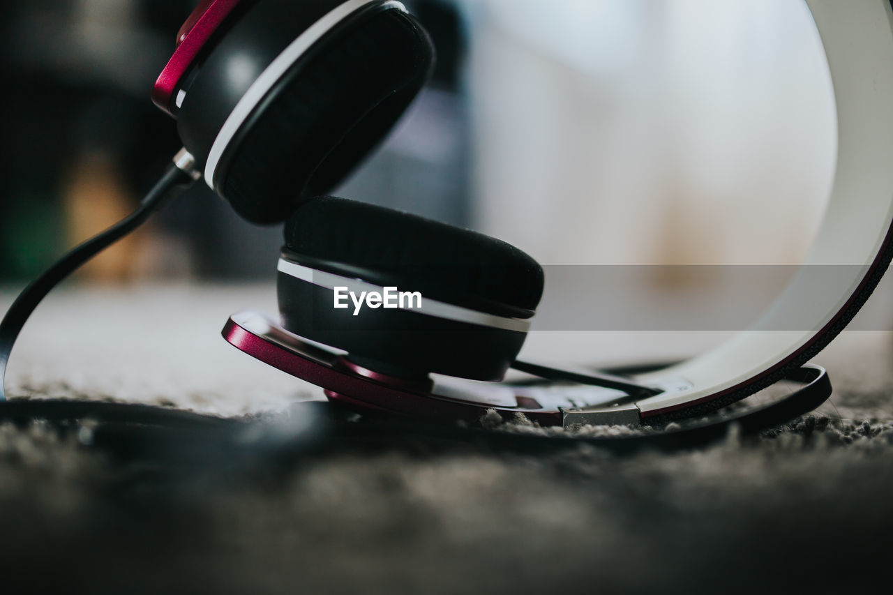 Close-up of headphones on rug
