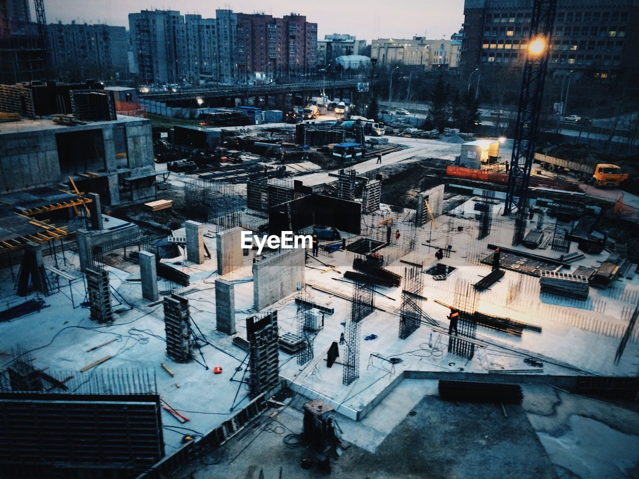High Angle View Of Construction Site In City At Dusk