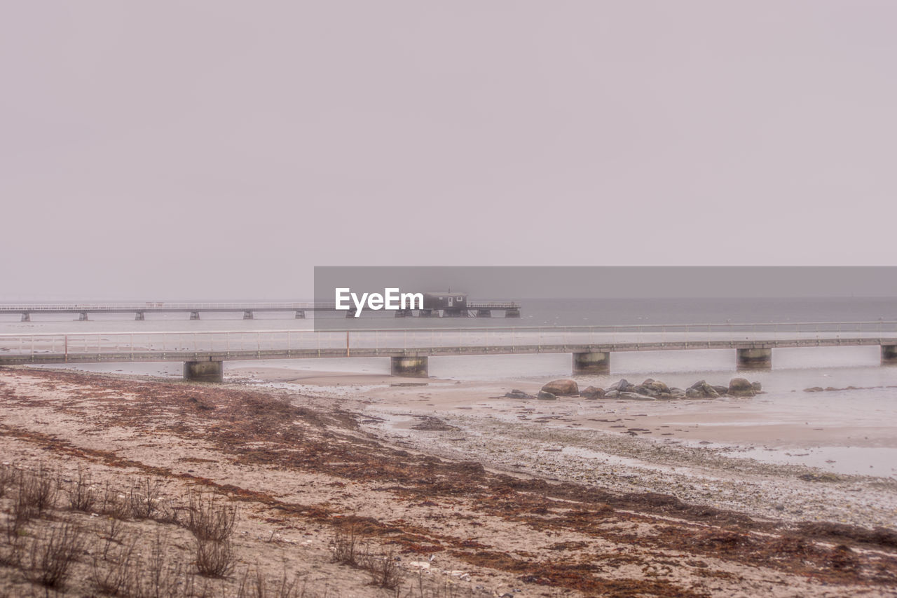Scenic View Of Sea Against Clear Sky During Foggy Weather