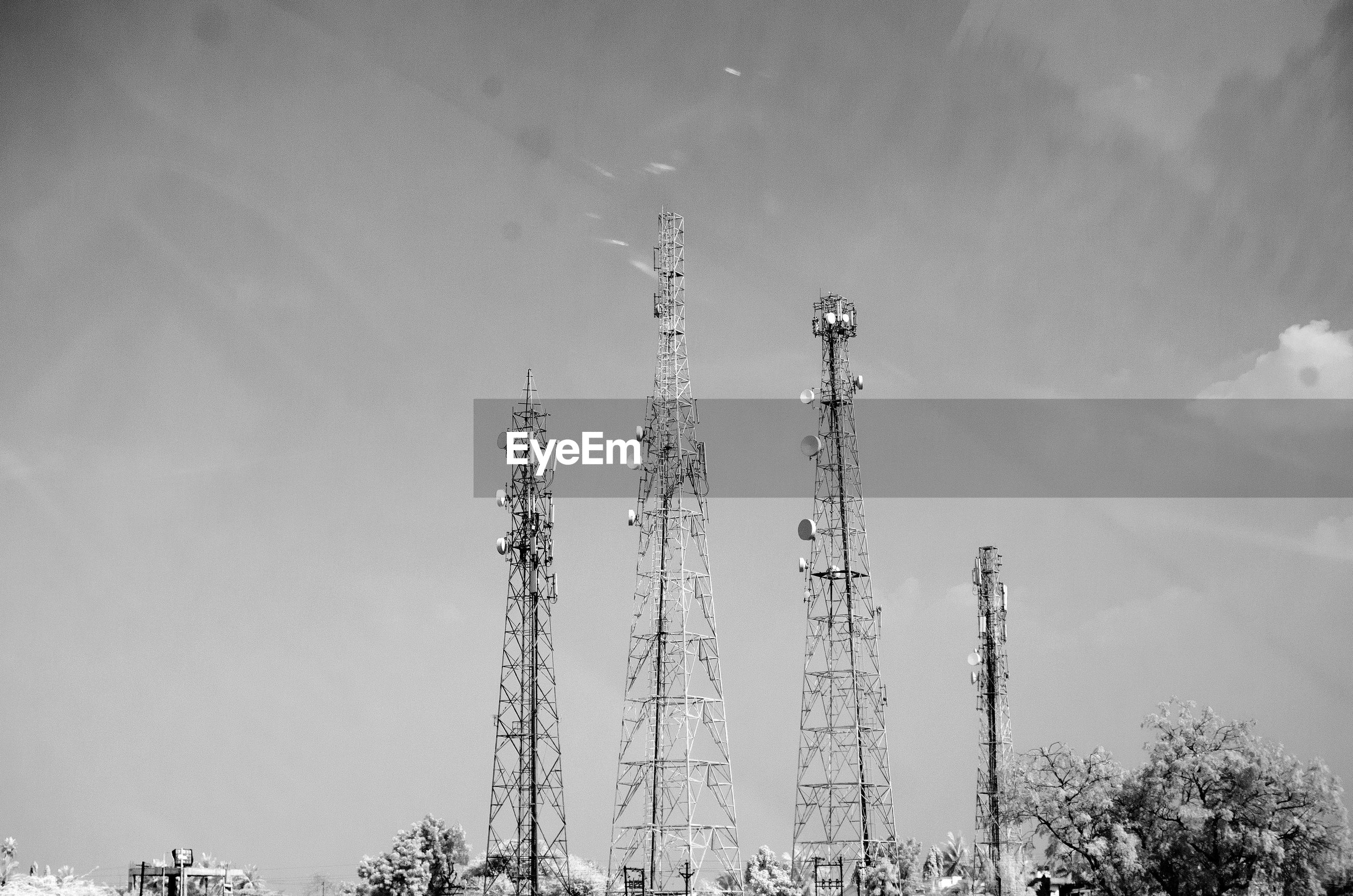 Communications towers against sky