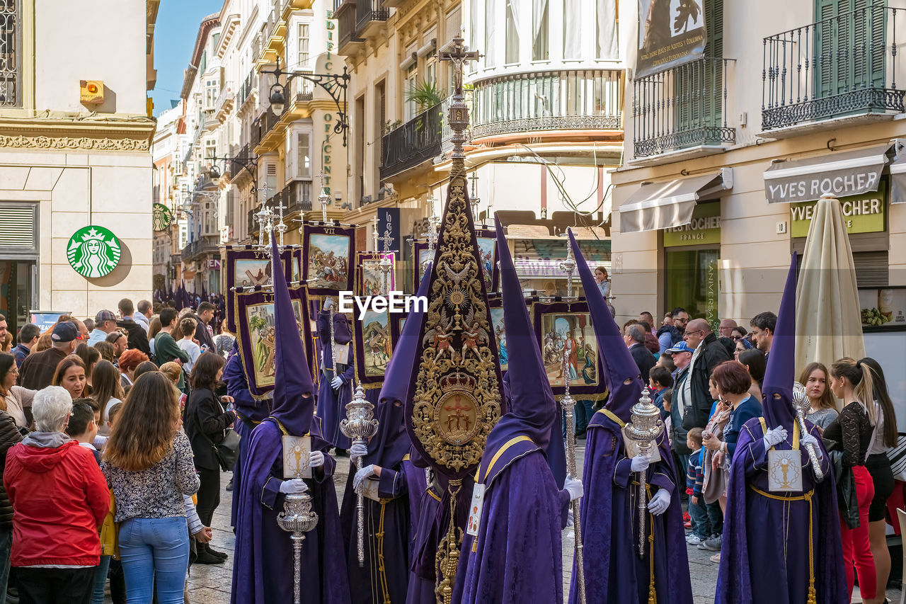 group of people, real people, crowd, large group of people, architecture, building exterior, built structure, women, city, men, day, lifestyles, adult, street, celebration, religion, standing, togetherness, belief, outdoors, arms raised