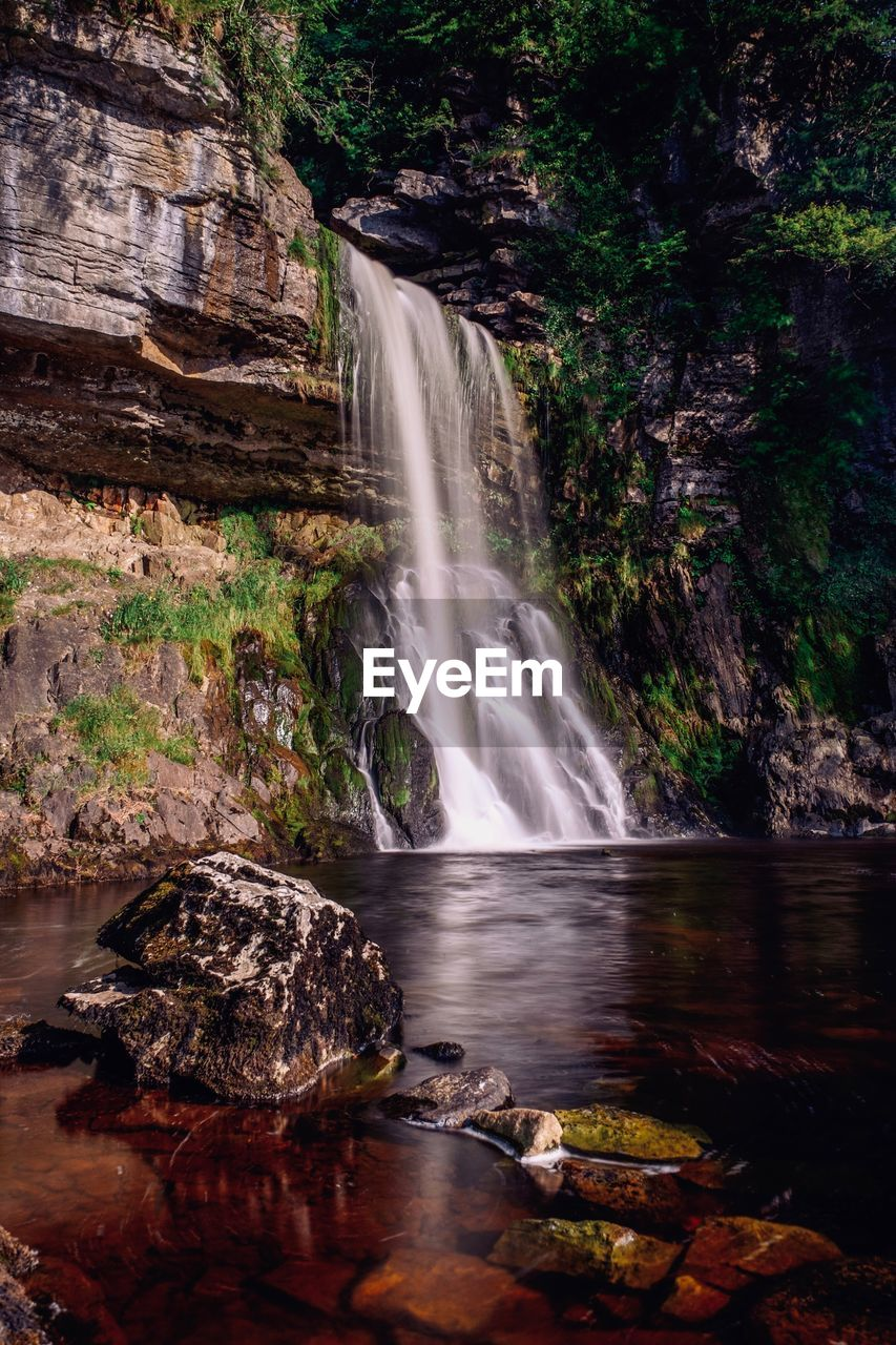 water, motion, long exposure, waterfall, blurred motion, rock, scenics - nature, flowing water, rock - object, beauty in nature, solid, nature, land, rock formation, forest, power, environment, tree, no people, power in nature, flowing, outdoors, rainforest, falling water, purity