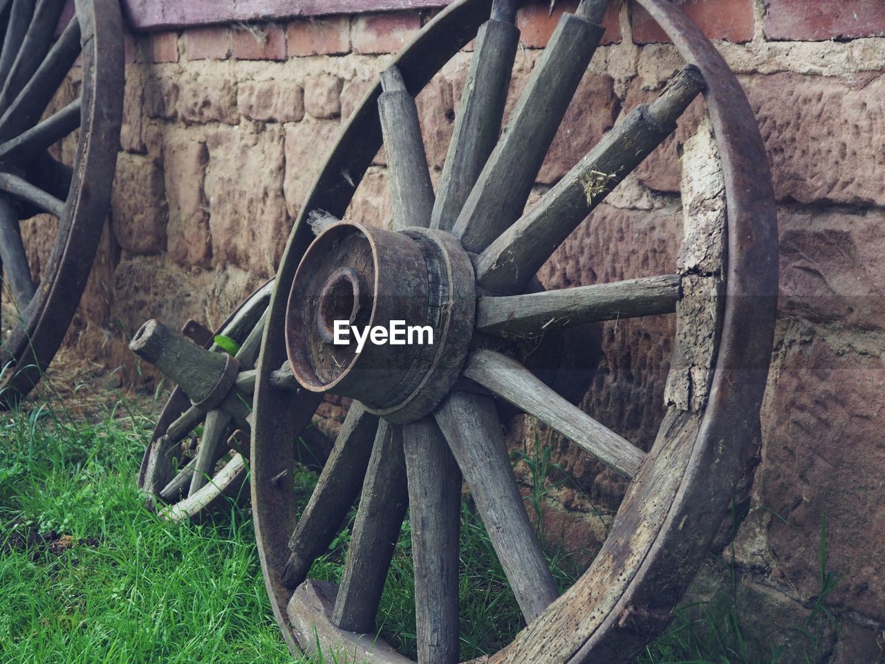 wheel, old, wagon wheel, no people, day, transportation, cart, metal, wood - material, obsolete, field, abandoned, rusty, outdoors, run-down, grass, nature, damaged, decline, deterioration, spoke