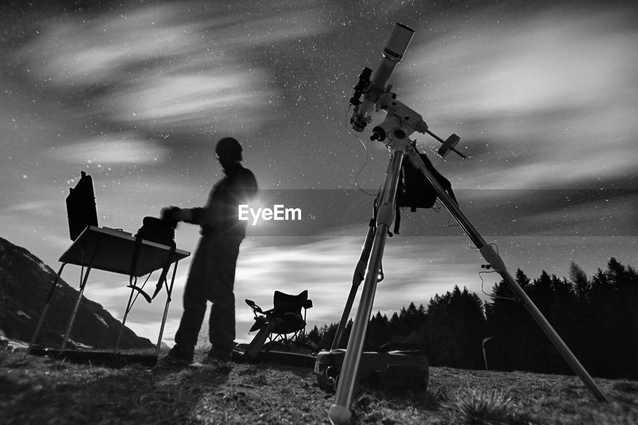 Men On Field Against Sky At Night
