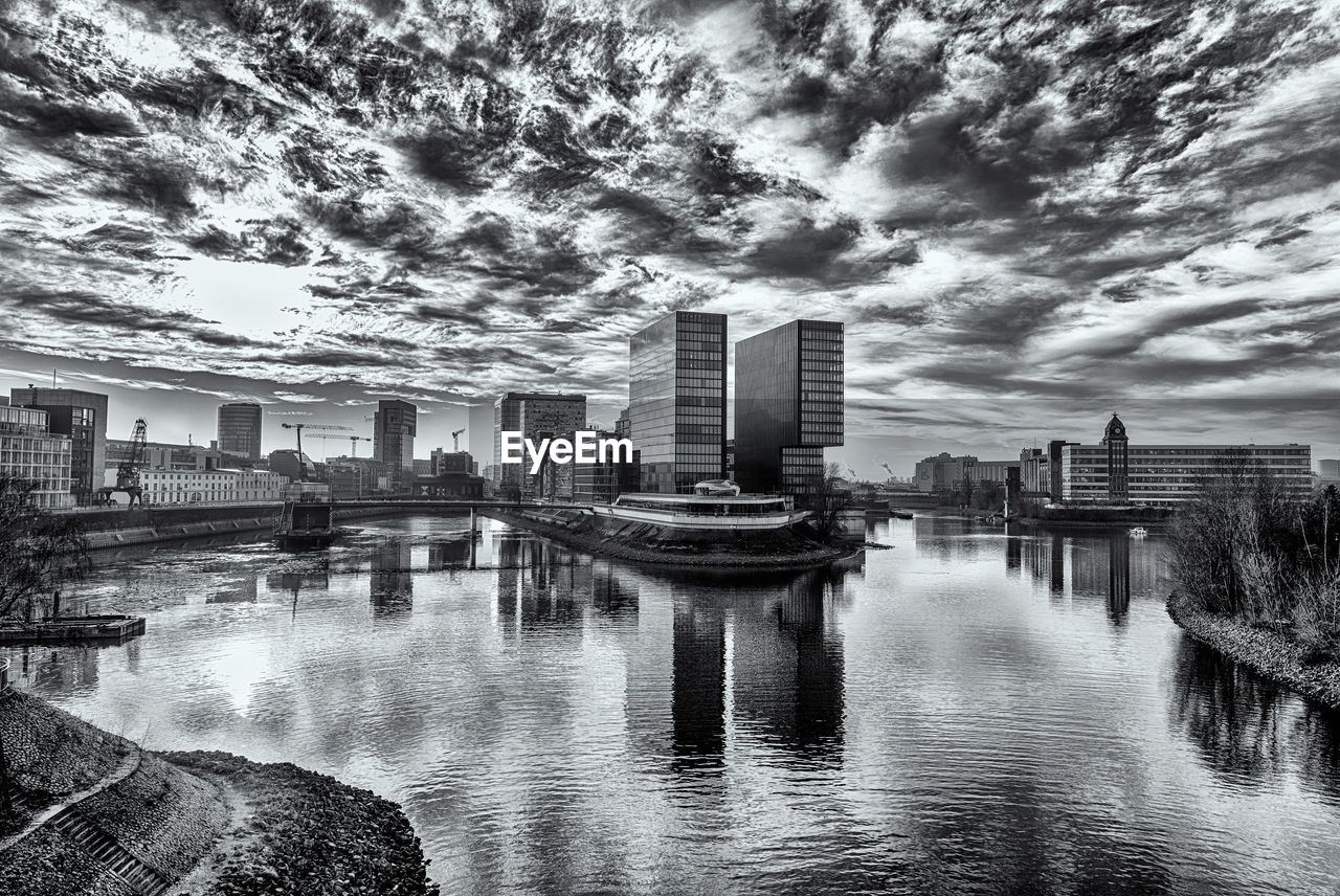 water, built structure, architecture, sky, building exterior, cloud - sky, reflection, city, building, nature, waterfront, no people, river, day, office building exterior, modern, outdoors, skyscraper, city life, cityscape, financial district