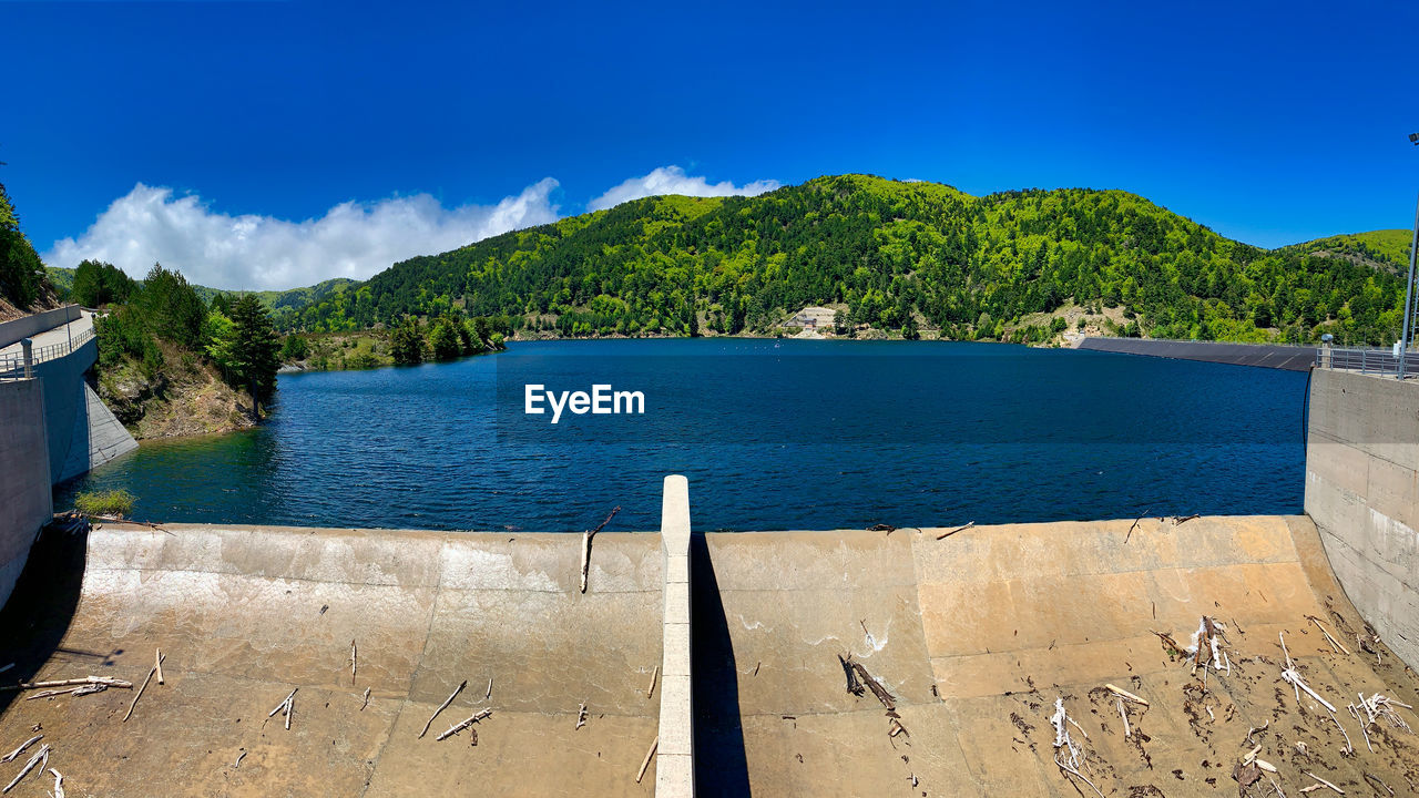 water, sky, scenics - nature, beauty in nature, nature, mountain, blue, tree, tranquil scene, tranquility, no people, day, plant, sunlight, sea, cloud - sky, non-urban scene, idyllic, outdoors