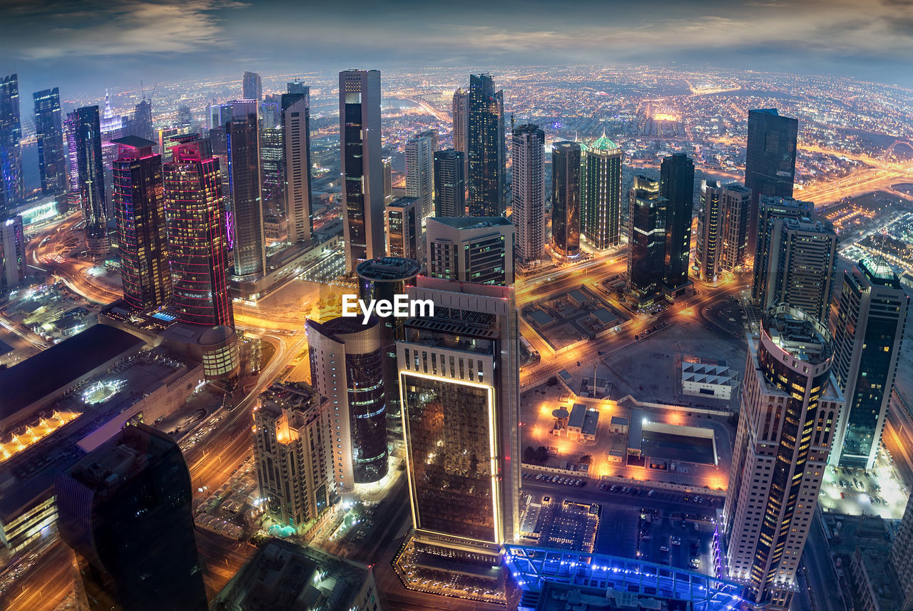 building exterior, city, architecture, built structure, cityscape, building, office building exterior, skyscraper, illuminated, tall - high, sky, landscape, urban skyline, crowd, modern, cloud - sky, crowded, tower, city life, financial district, outdoors