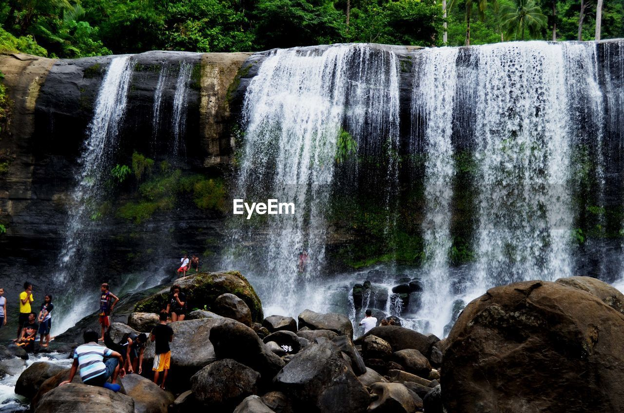 waterfall, water, flowing water, long exposure, motion, rock, scenics - nature, beauty in nature, nature, rock - object, splashing, blurred motion, solid, land, tree, outdoors, travel destinations, flowing, forest, power in nature, falling water, rainforest