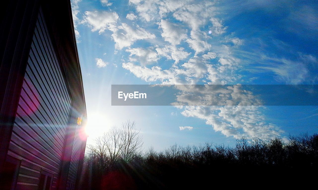 sky, sunbeam, lens flare, sun, sunlight, cloud - sky, no people, low angle view, day, outdoors, nature, architecture, building exterior, beauty in nature, tree