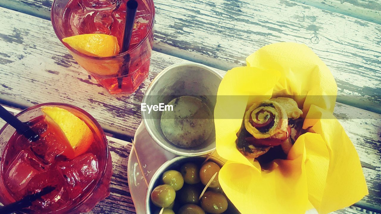 food and drink, refreshment, freshness, lemon, drinking glass, table, drink, healthy eating, fruit, slice, ice, no people, ice cube, food, high angle view, drinking straw, cold temperature, citrus fruit, yellow, indoors, close-up, ready-to-eat, day