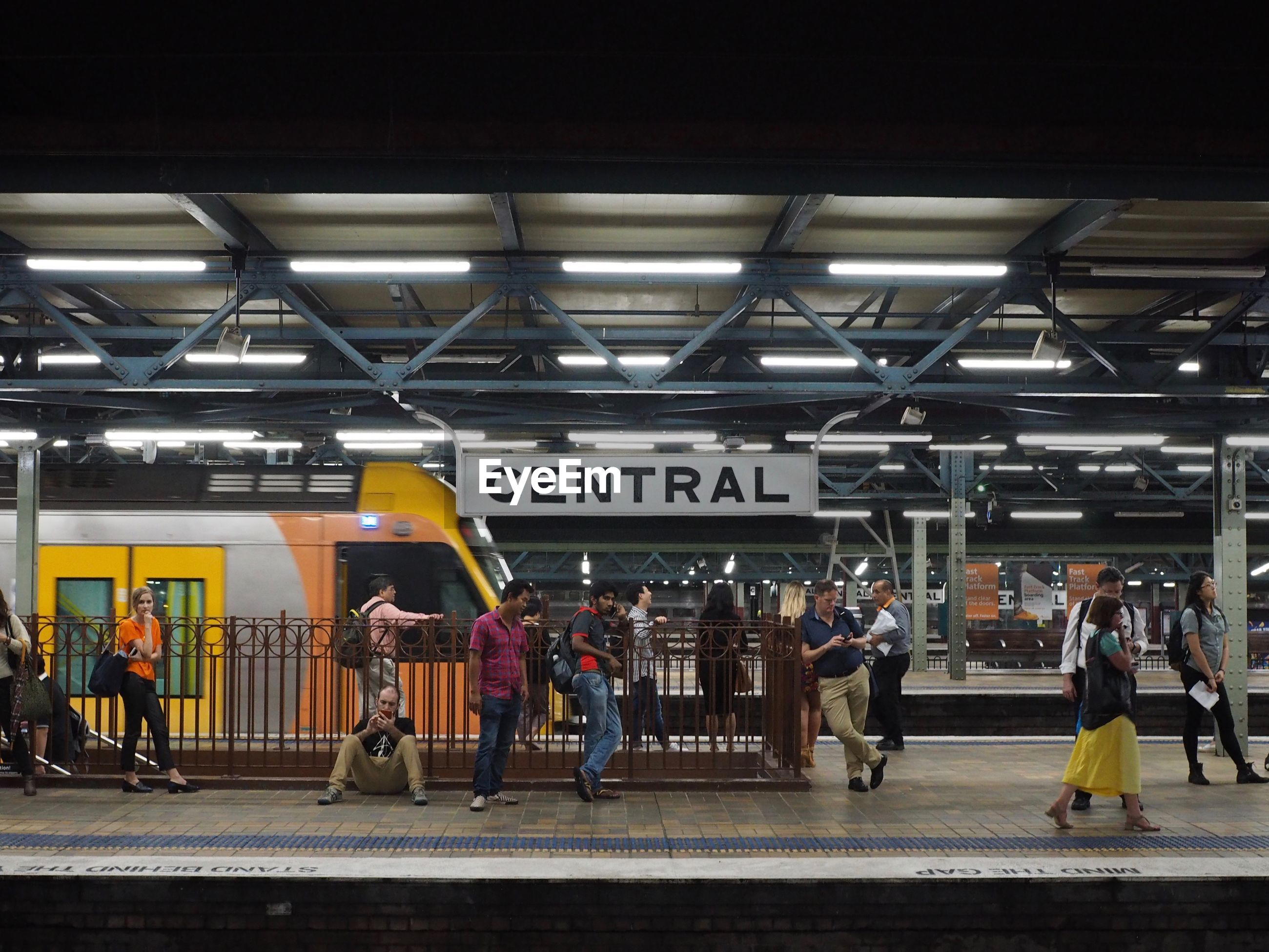subway station, large group of people, men, public transportation, real people, train - vehicle, women, indoors, transportation, rail transportation, architecture, full length, subway train, musician, day, adult, people, adults only