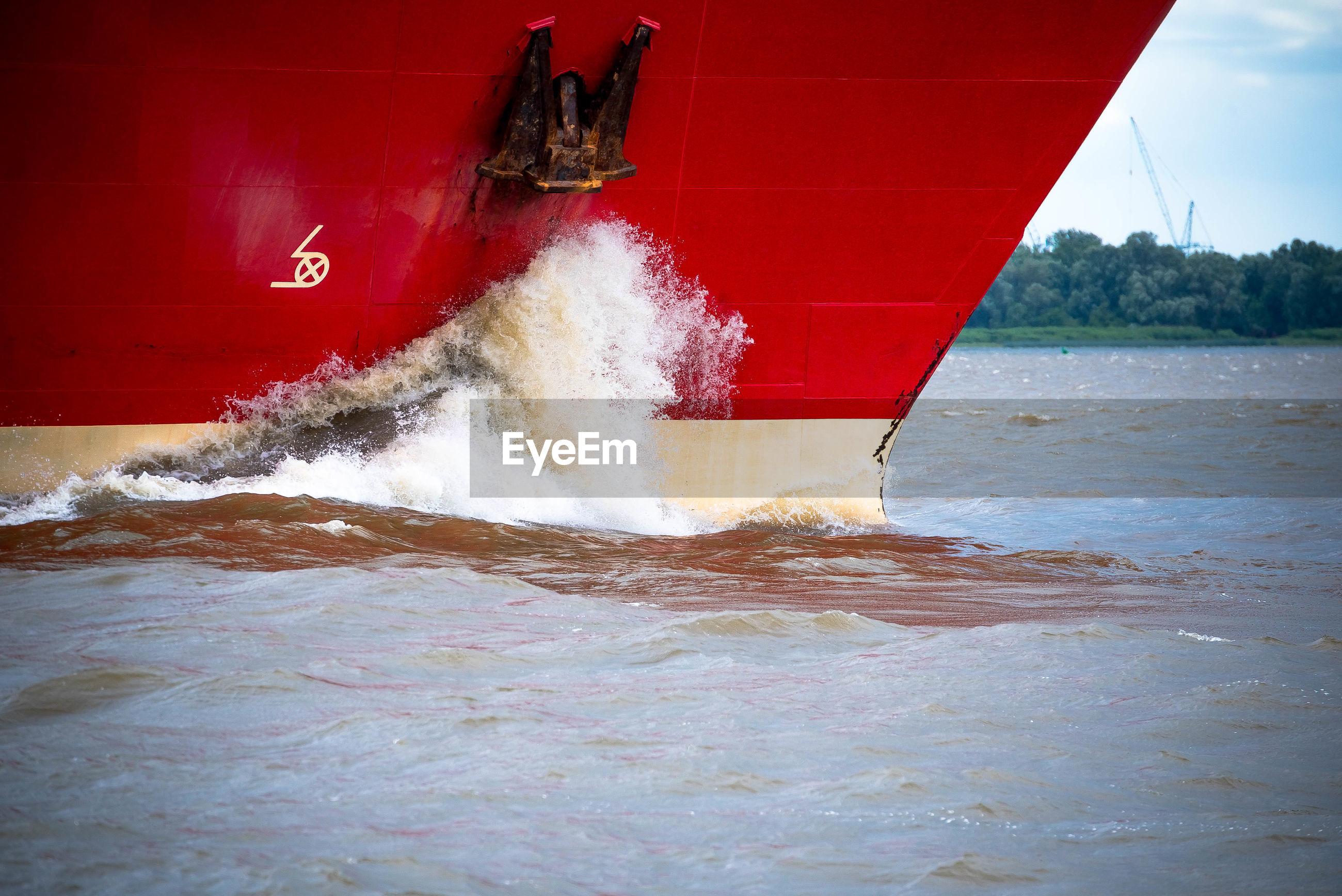 Water splashing on boat in sea
