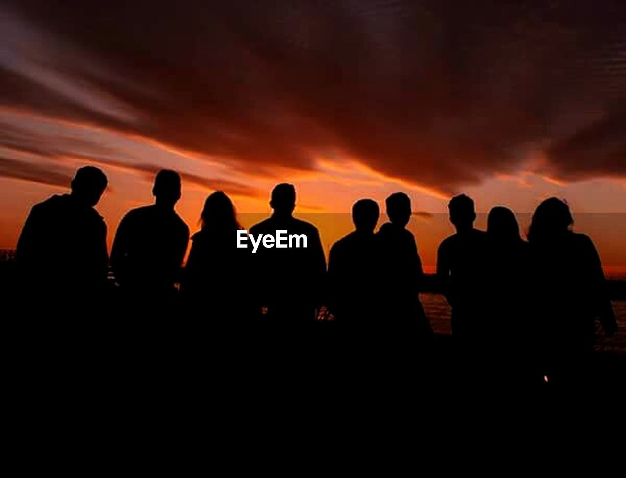 silhouette, sunset, orange color, togetherness, standing, friendship, large group of people, outdoors, people, nature, sky, adult, day