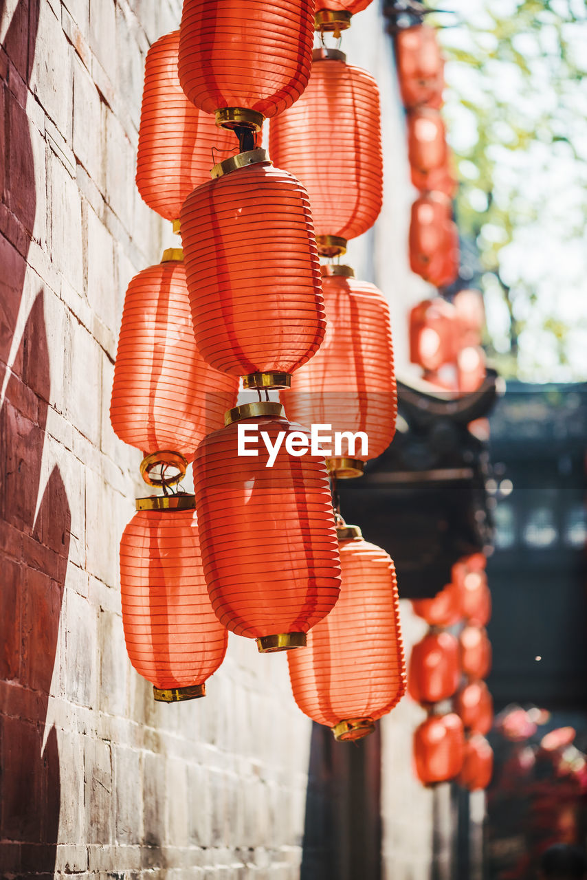 Low angle view of lanterns hanging outdoors
