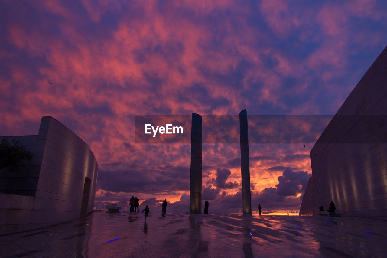 sunset, built structure, sky, architecture, real people, building exterior, cloud - sky, outdoors, winter, city, nature, day