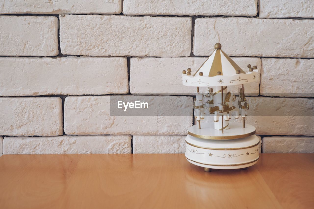wall - building feature, no people, wall, indoors, brick wall, brick, white color, wood - material, built structure, close-up, architecture, day, metal, table, home interior, flooring, lighting equipment, simplicity, white, small