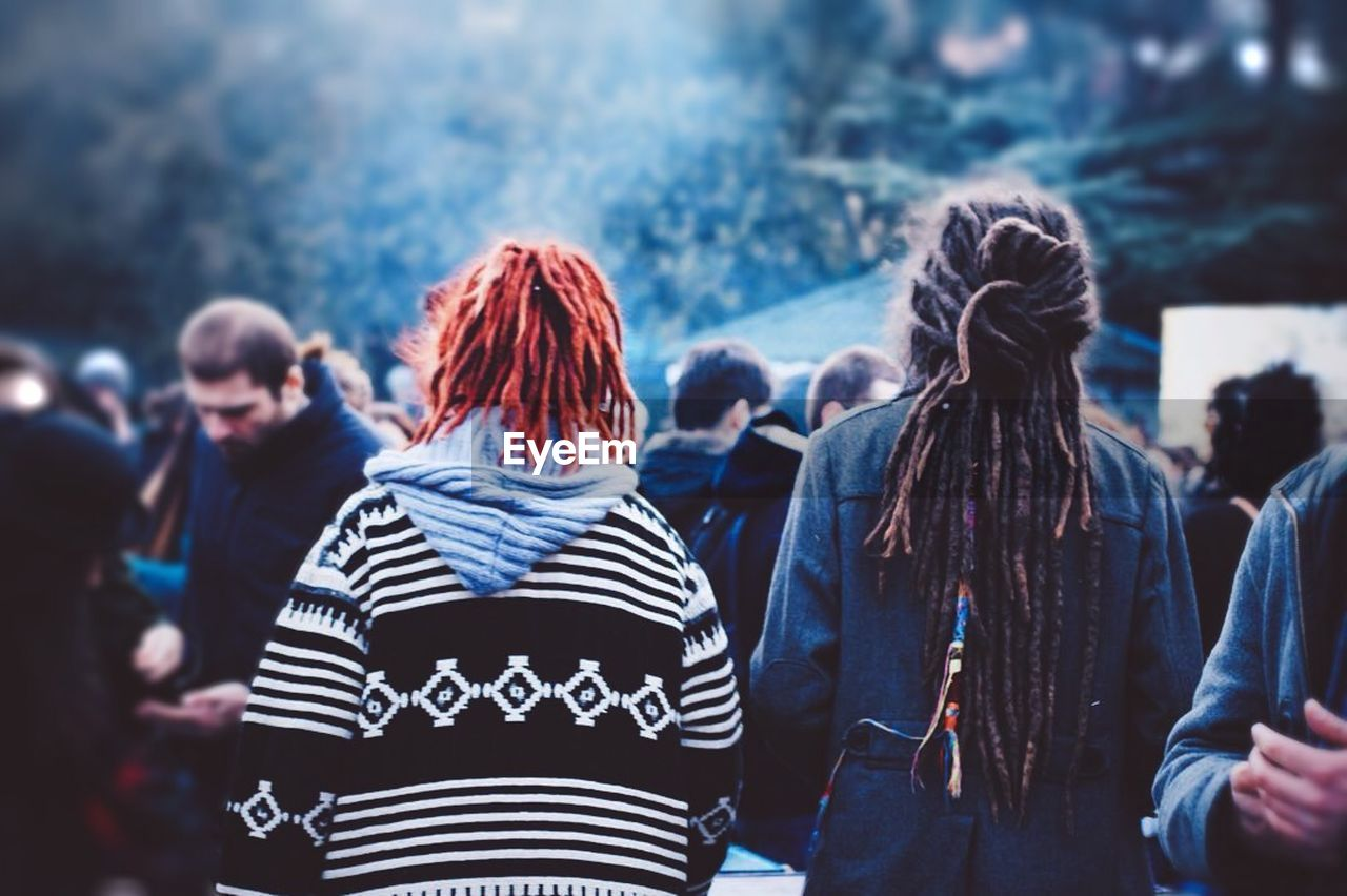 rear view, real people, people, lifestyles, group of people, adult, focus on foreground, women, casual clothing, leisure activity, men, crowd, togetherness, striped, standing, outdoors, incidental people, clothing, day, hairstyle, festival