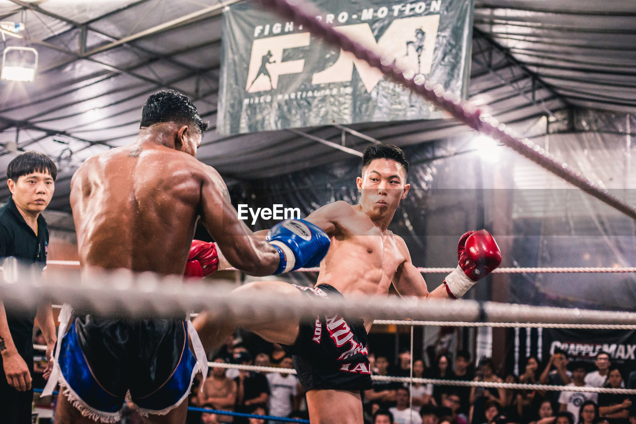 sport, competition, boxing - sport, athlete, determination, group of people, vitality, strength, healthy lifestyle, boxing ring, muscular build, competitive sport, people, men, adult, young men, exercising, real people, lifestyles, motion, punching, effort