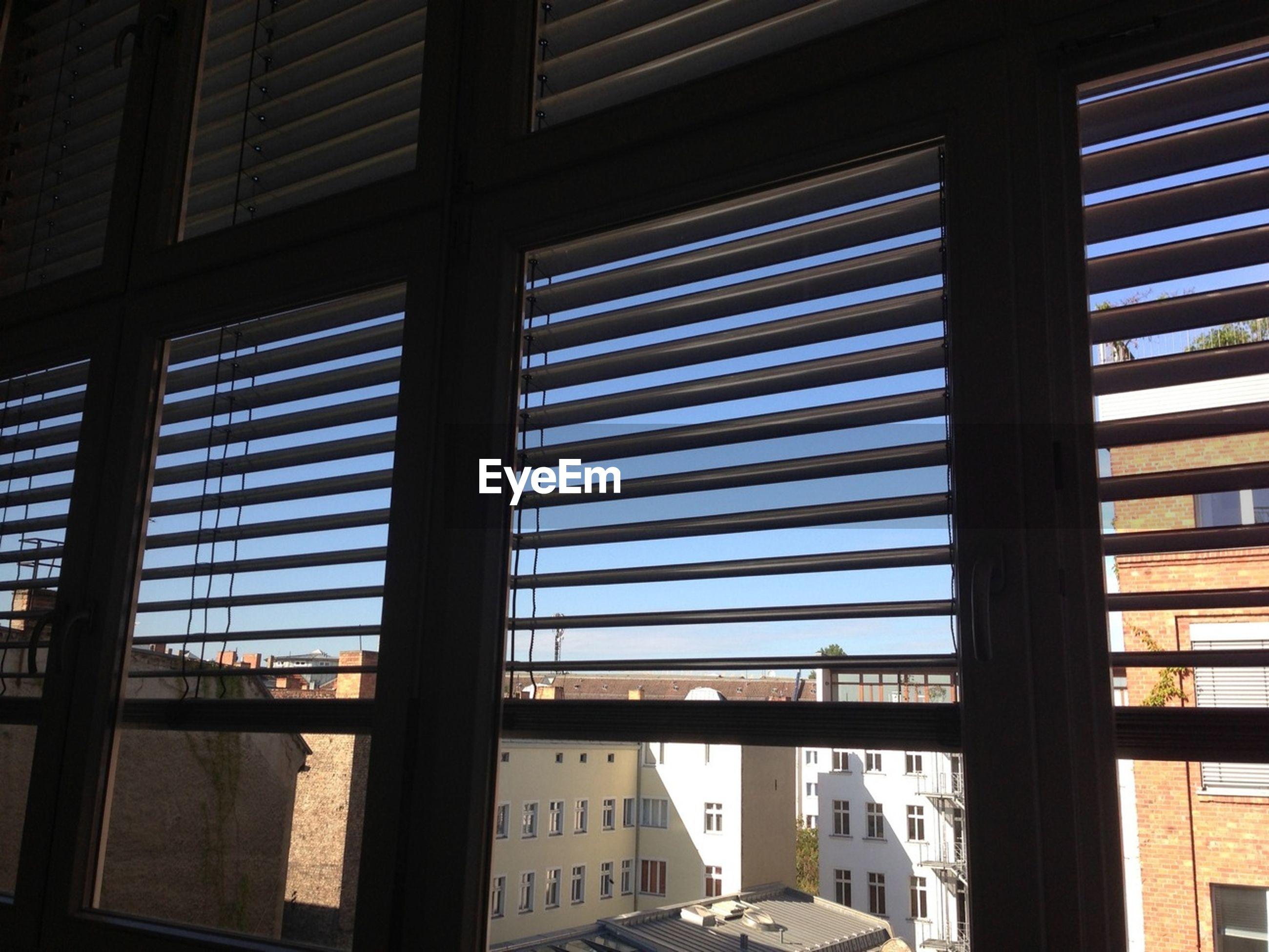 City seen through window blinds
