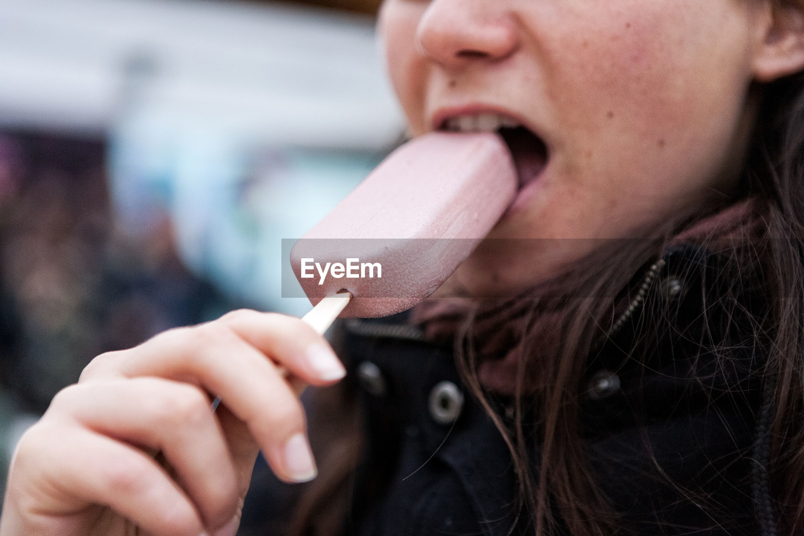 Close-up portrait of a woman eating icecream