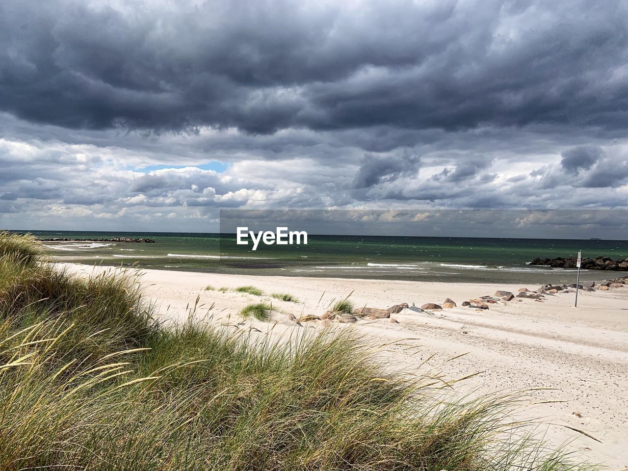 cloud - sky, sky, land, beauty in nature, water, beach, scenics - nature, sea, plant, grass, sand, nature, tranquility, tranquil scene, day, horizon, non-urban scene, no people, horizon over water, marram grass, outdoors