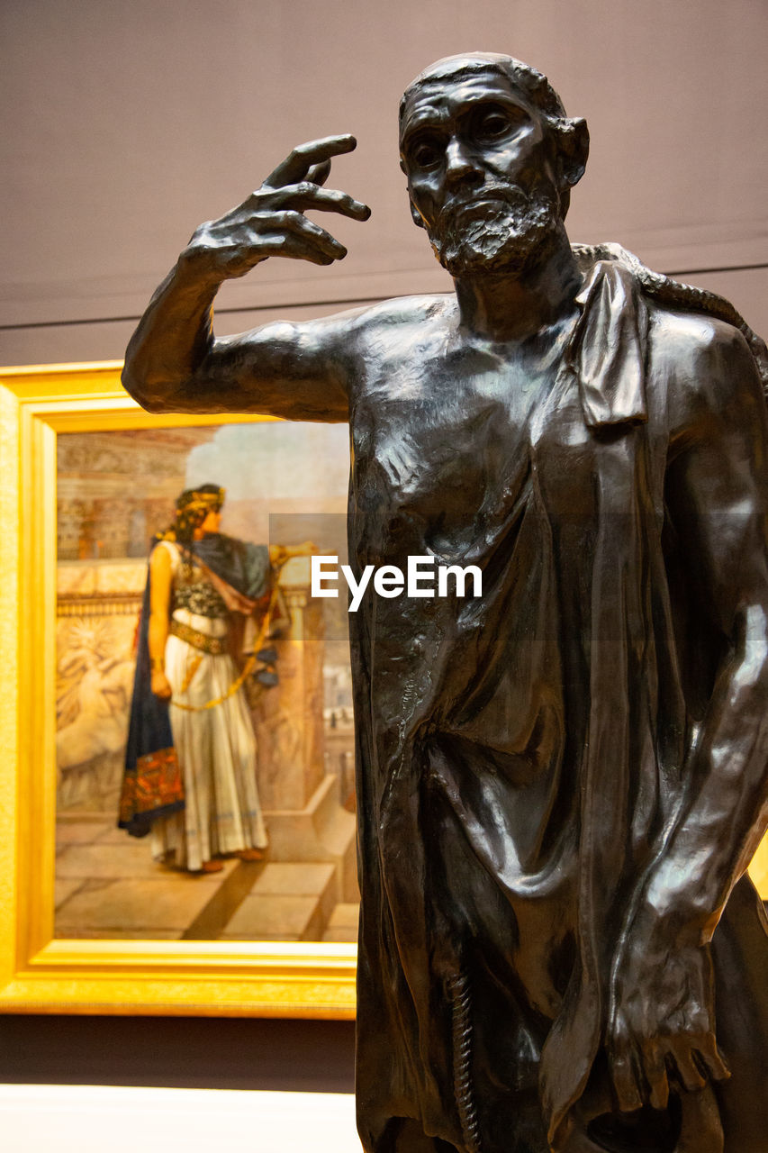 representation, human representation, sculpture, statue, male likeness, art and craft, indoors, creativity, female likeness, no people, craft, architecture, transparent, figurine, museum, front view, focus on foreground, carving - craft product, standing