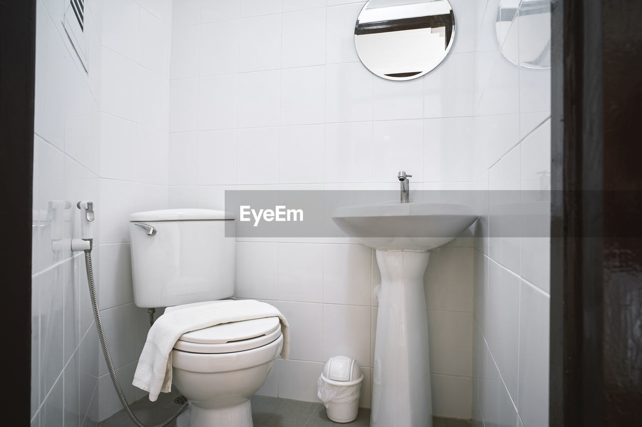 bathroom, toilet, hygiene, toilet bowl, domestic bathroom, indoors, tile, home, flooring, white color, public restroom, domestic room, convenience, no people, public building, flushing toilet, clean, tiled floor, urinal, absence