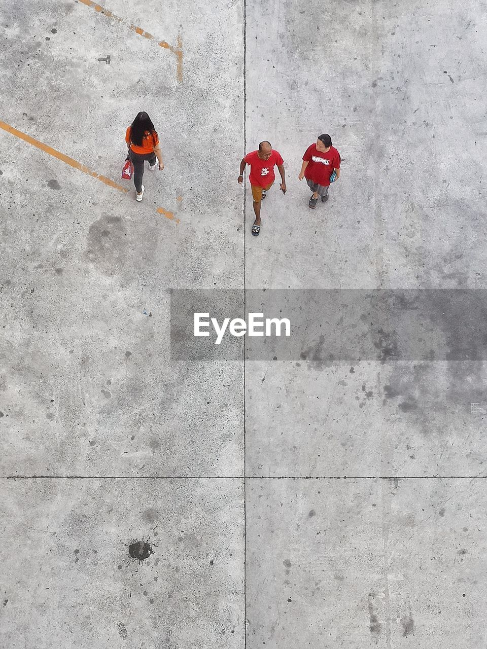 high angle view, red, day, real people, women, walking, lifestyles, group of people, flooring, outdoors, directly above, men, people, nature, sunlight, full length, footpath, tile, architecture, unrecognizable person, tiled floor