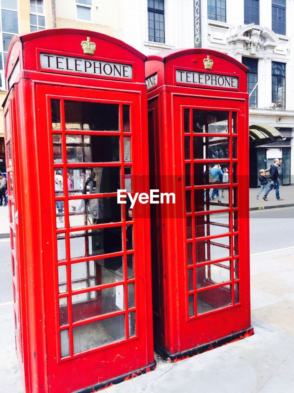 red, communication, telephone booth, pay phone, text, connection, day, outdoors, architecture, building exterior, built structure, convenience, technology, telephone, city, no people, close-up