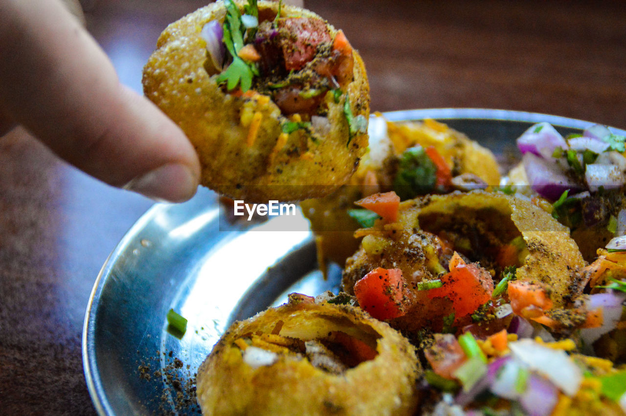 Pani Puri Pani Puri Real Indian Street Food Food One Person Human Hand Eating Street Food Ready-to-eat Close-up Freshness Nepal Food And Travel Culture And Cuisine Culture And Tradition Street Food Worldwide